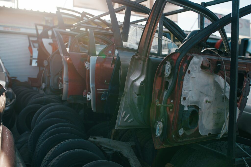 Car parts and tires on junkyard, nobody